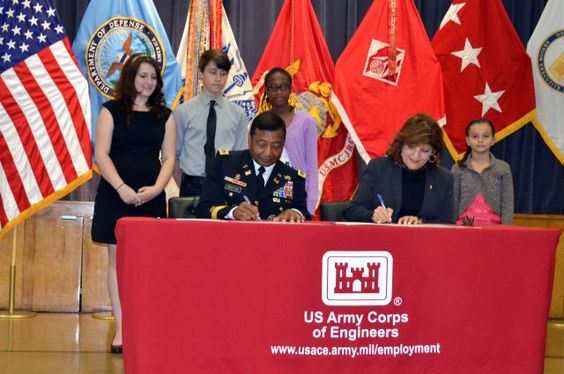 Lt. Gen. Thomas Bostick, U.S. Army Corps of Engineers commanding general, and Marilee Fitzgerald, DoDEA director, sign the memorandum of und...