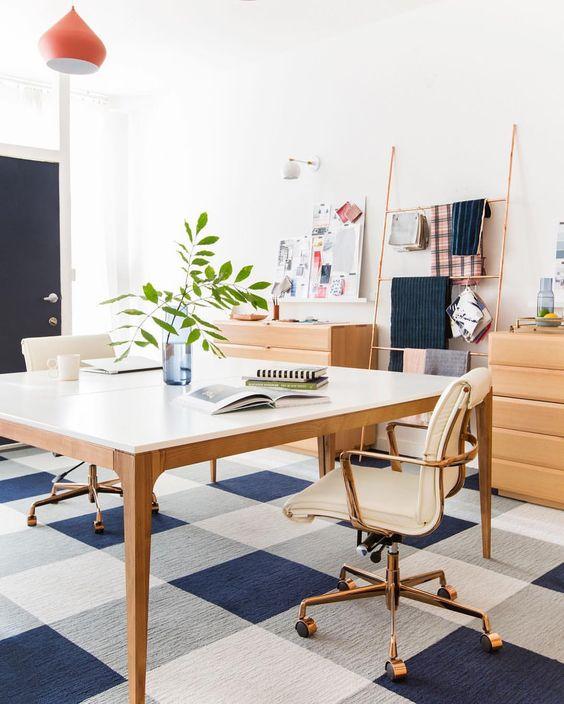 Create a feature using cost-effective carpet tiles. Image via Pinterest