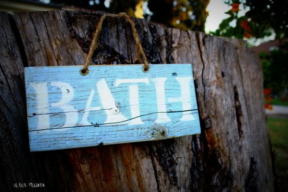 blue bath sign made from natural wood