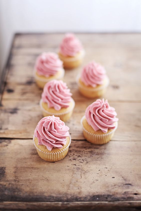 Blondie cupcakes with raspberry buttercream frosting