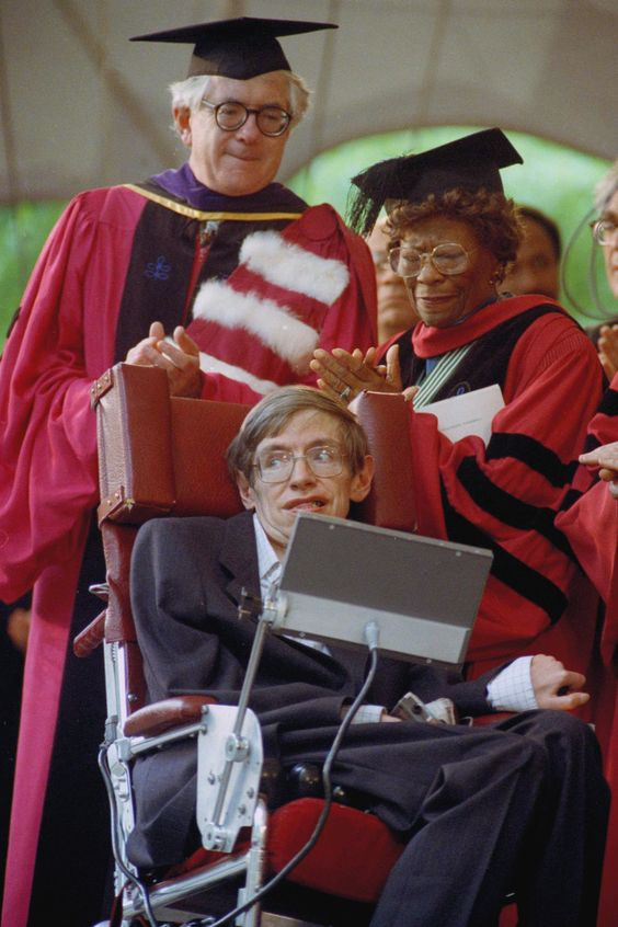 Famed jazz singer Ella Fitzgerald (back right) applauds renowned theoretical physicist Stephen Hawking, as he given an honorary degree, Doctor of Science, at the 339th Harvard University commencemen in 1990. Photo: Charles Krupa/AP