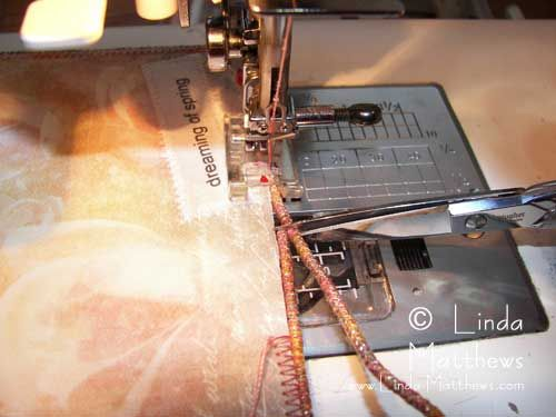 Tutorial: Finishing the edges of fabric postcards with wrapped cording - http://www.linda-matthews.com/making-fabric-postcards-finishing-the-edges/