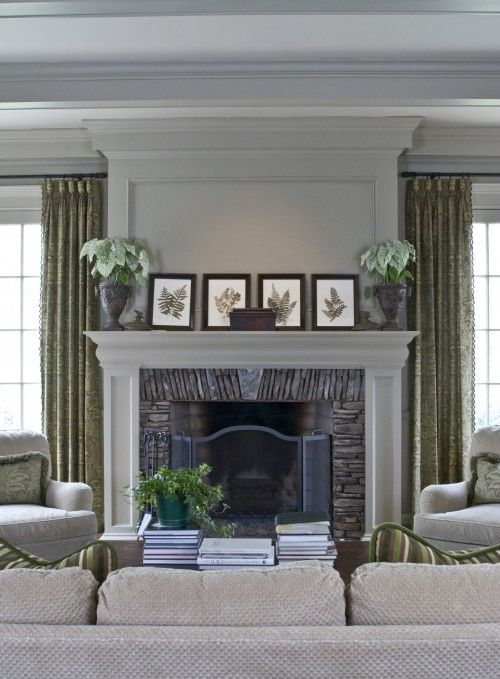 looks a bit like my fireplace wall...except I have a tv over the fireplace...ideas though for color and window treatments