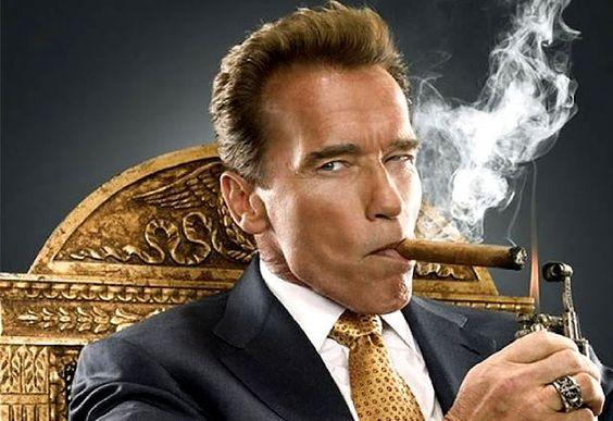 Arnold Schwarzenegger smoking a cigar