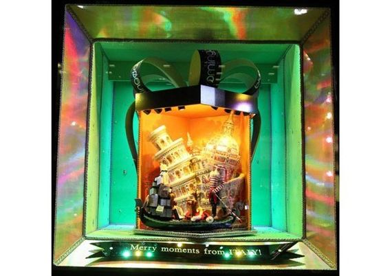 NYC's Best Holiday Windows: Our Virtual Tour. Bloomingdale's celebration of Venice with the Leaning Tower of Pisa.