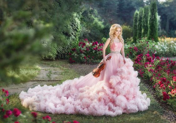 Sweet and romantic pink bridal gown from Art Dress featuring a cloud-like dreamy train!