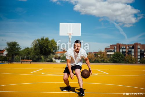 Man Playing Basketball On Yellow Court Dribbling Affiliate Basketball Playing Man Dribbling Court Ad In 2020 Man Stock Photos Photo
