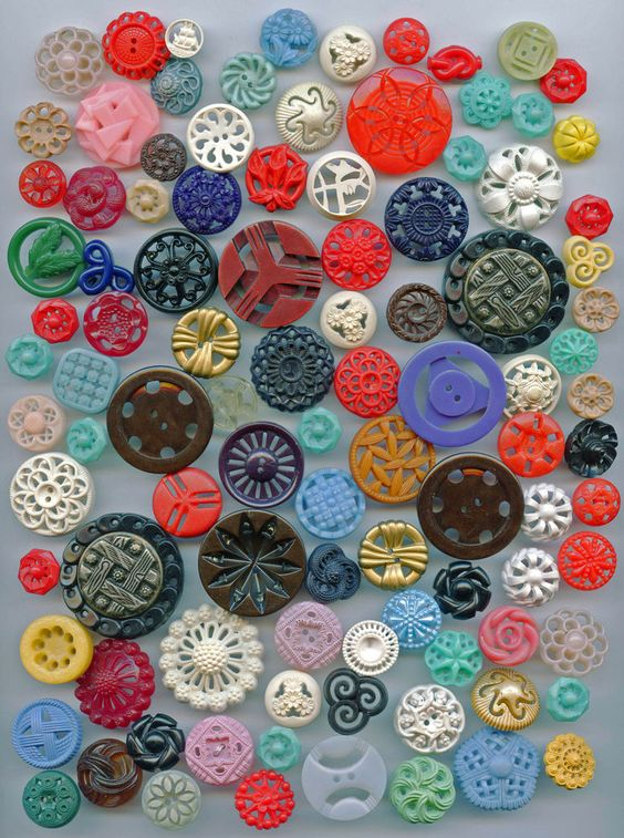 SOLD: Lot of vintage pierced plastic buttons