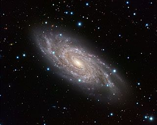 "The Blinking Galaxy: NGC 6118, a grand-design spiral galaxy, shines bright in this image, displaying its central bar and tight spiral arms from its home in the constellation of Serpens (The Snake). The galaxy is sometimes known to amateur astronomers as the ""Blinking Galaxy"" because this relatively faint, fuzzy object would appear to flick into existence when viewed through their telescopes in a certain orientation, and then suddenly disappear again as the eye position shifted."