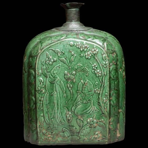 Flask with music scene Iran, c. 1640-1665 Stonepaste, with molded decoration under a colored glaze H. 22.5 cm; W. 9.8 cm Musée du Louvre, gift of Louis Hugot, 1924 OA 7780.