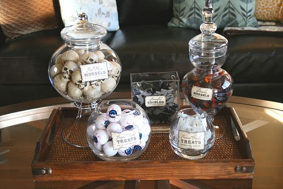 We did this for our 2011 Halloween party.  Super cute.  Filled Jars with items from dollar store