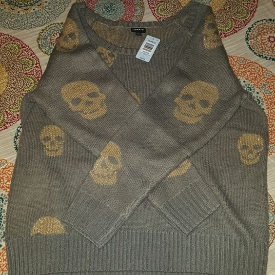 Torrid skull sweater Brand new with tags. Awesome gray with gold skulls sweater. Torrid size 2 like a 18-20. torrid Sweaters Crew & Scoop Necks