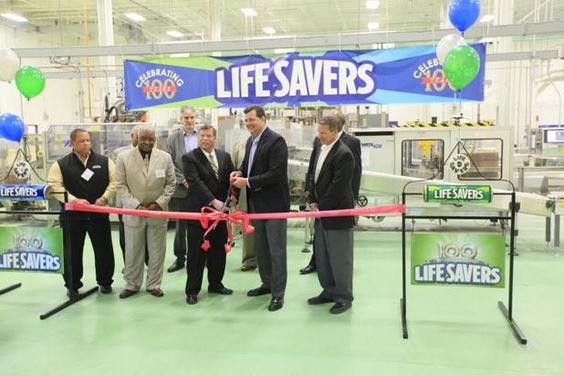 Wrigley and local government officials perform a ribbon-cutting at their Chattanooga plant Wednesday celebrating 100 years of Life Savers.