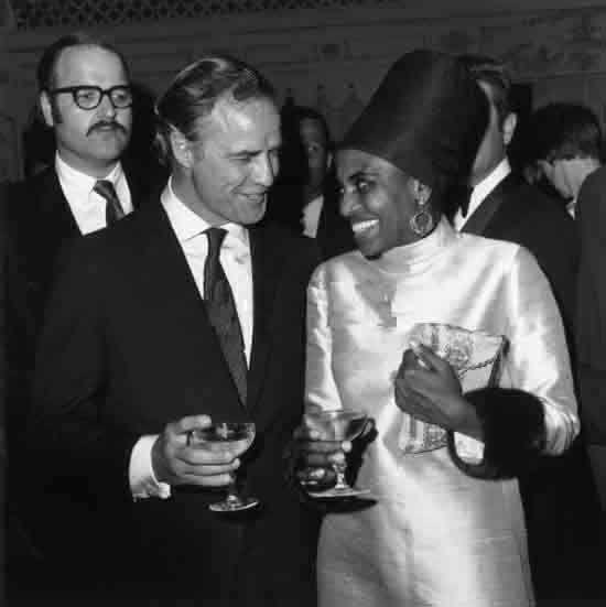 Miriam Makeba and Marlon Brando enjoying champagne on Ms. Makeba's opening night at the Cocoanut Grove in LA on April 2, 1968 via Vintage Black Glamour blog