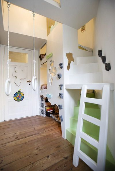 A climbing wall, bunks, ladders, nooks, a swing – this kids room has it all!