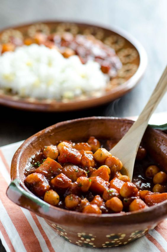 This sweet potato and chickpea stew combines sweet potatoes, yukon gold potatoes and chickpeas in a classic chile colorado sauce.: