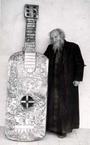 Who could strum that thing?! Father Grundi with an Atlantean Instrument of Nephilim Proportions. WE Love it when he comes round for a jam, he can play a groovy sensational version of 'The Red Flag'