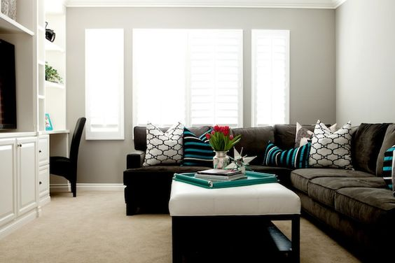 living rooms - Windsor Smith Riad gray walls espresso microfiber sectional sofa white leather tufted ottoman turquoise blue black striped pillows
