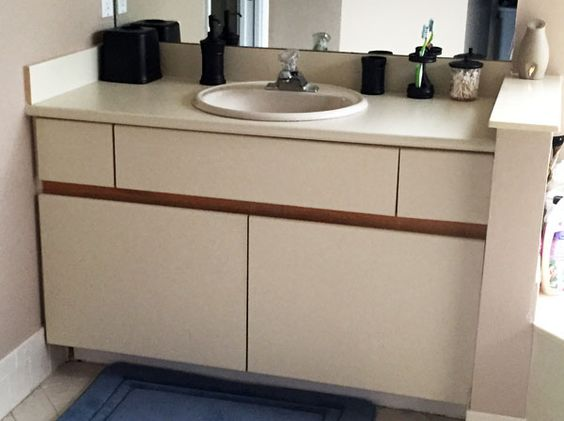 Diy inexpensive bathroom cabinet makeover how to paint - Painting laminate bathroom cabinets ...