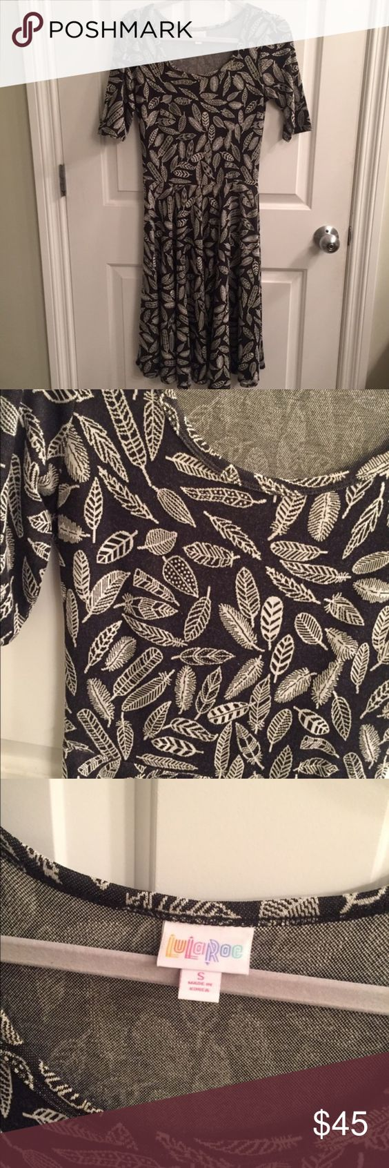 Lularoe LLR Nicole dress feathers black and white Excellent condition, only worn once for a couple of hours. I love the pattern and feel of the dress, but I never reach for it. LuLaRoe Dresses