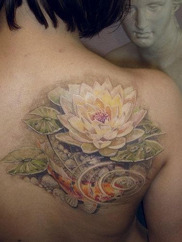 Koi Lotus tattoo.. Now this is some dope fuking realism for that ass!!