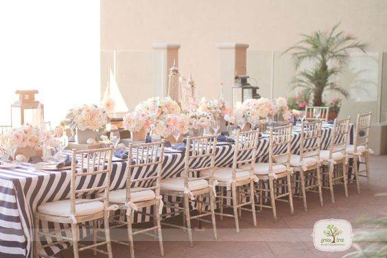 centerpieces on risers..makes it feel even more grand!