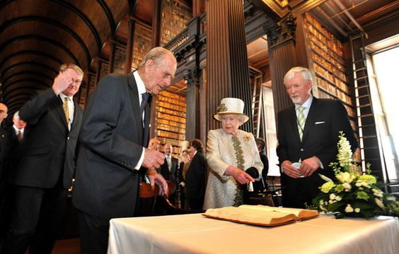 Queen Elizabeth II  and Prince Philip, Duke of Edinburgh sign the visitors book in the Long Room during a visit to Trinity College Dublin on May 17, 2011 in Dublin, Ireland. The Queen's visit, accompanied by The Duke of Edinburgh, is the first by a monarch since 1911. An unprecedented security operation is taking place with much of the centre of Dublin turning into a car free zone. Republican dissident groups have made it clear they are intent on disrupting proceedings