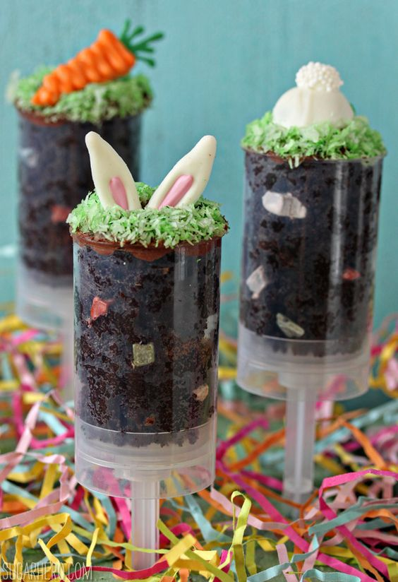 """Easter Cake Push Pops   These Easter Cake Push Pops really are easy to make–they're basically cake and frosting mixed together, to form a moist, dense """"dirt."""" @elabau"""