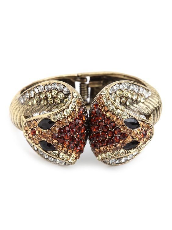Take a walk on the fabulously wild side with this superbly glamorous cuff. It features a cool cobra motif that's simply dripping in dazzling gemstones and crystals.