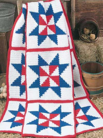 Reminiscent of an old fashioned Americana quilt, the bold Patriotic Pinwheel Afghan is an easy free crochet afghan pattern available at Freepatterns.com.: