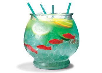 """SUMMER DRINK! ½ cup Nerds candy  ½ gallon goldfish bowl  5 oz. vodka  5 oz. Malibu rum  3 oz. blue Curacao  6 oz. sweet-and-sour mix  16 oz. pineapple juice  16 oz. Sprite  3 slices each: lemon, lime, orange  4 Swedish gummy fish    Sprinkle Nerds on bottom of bowl as """"gravel."""" Fill bowl with ice. Add remaining ingredients. Serve with 18-inch party straws."""