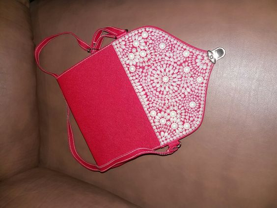 this stunning red sling that is uniquely designed ....,, overloaded with Pearls....this eye-catching sling is a sort of accessory that you want to carry at Cocktail night and official dinner gathering or a day wear affairs.