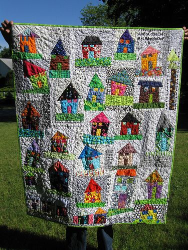 This would be a fun quilt to do by having a bunch of kids draw the house pictures!
