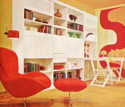 White wall units, red chair again!