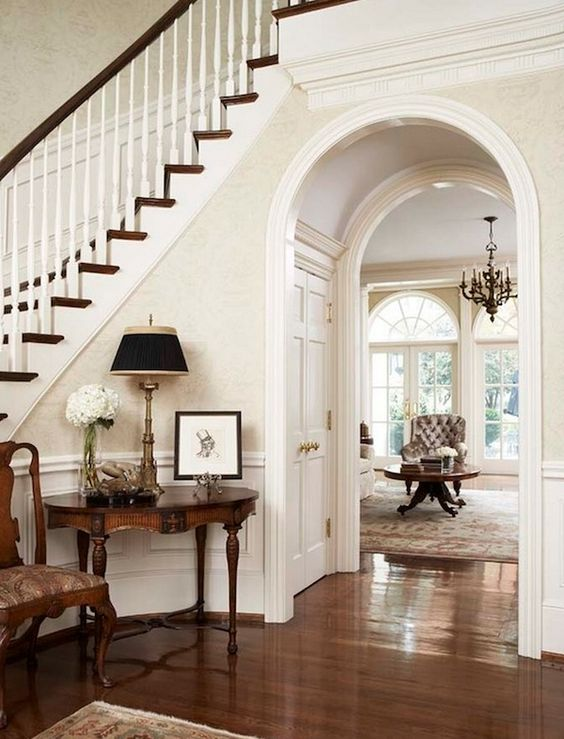 home foyer with  wainscoting and hard floor, love the feeling in this entry, it's all the details