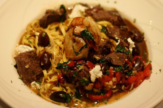 Steak & Shrimp-        Tenderloin tips, shrimp, basil,  roasted pepper, Kalamata olives,  goat cheese, linguini, x-tra virgin olive  oil & balsamic reduction