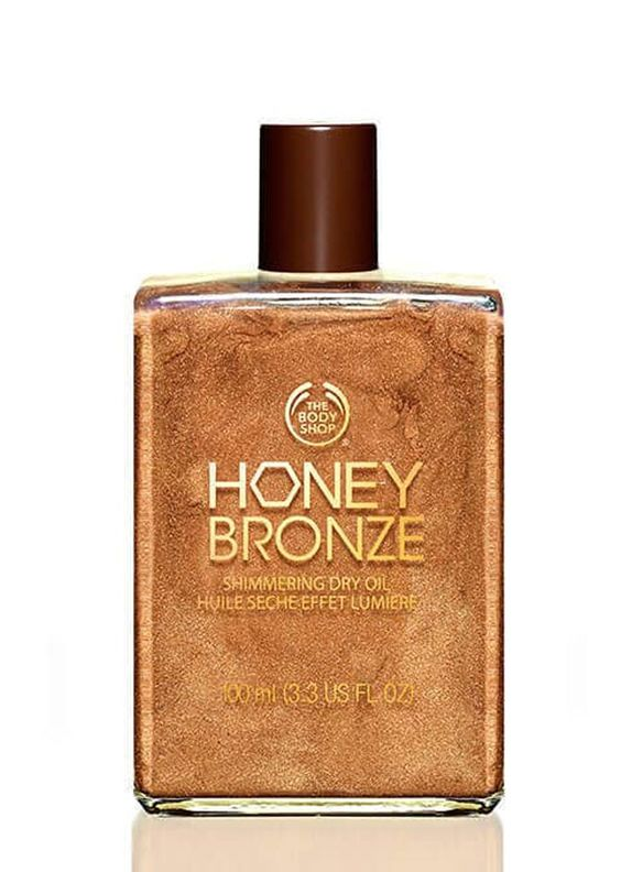 STYLECASTER | Shimmer Body Oil | Bronze Body Oil | Self Tan Oil | Best Bronzing Body Oils | The Body Shop Honey Bronze Shimmering Dry Oil