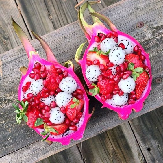 """Dragon fruit """"bowls"""" filled with dragonfruit, strawberries, & pomegranate!"""