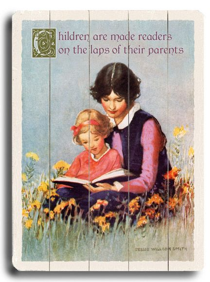 Children are made readers on the laps of their parents.: