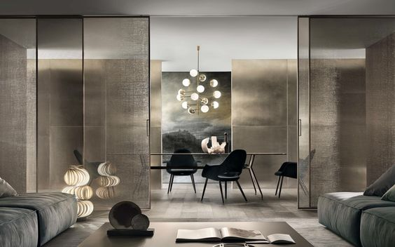 The Velaria door from Pure Interiors by Rimadesio | The sliding door panels are custom made with a slender aluminium structure that makes the most of the exclusive range of Rimadesio glass.