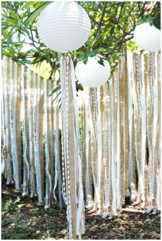 pretty wedding decor idea using paper lanterns and ribbons