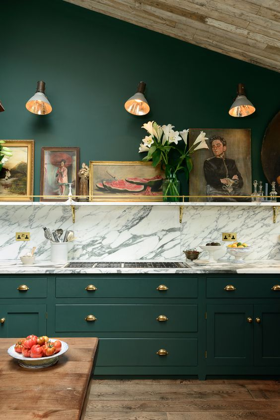 on the cupboards is a cross between emerald and racing green, a great contrast to the deVOL brass door furniture, it is quite a change from the soft muted colours our customers usually choose, but it creates a fabulously dramatic and atmospheric kitchen.