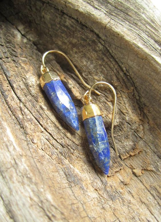 Natural blue lapis lazuli points dangle from 14K gold fill earwires. Faceted points are a rich blue color with flecks of gold throughout.