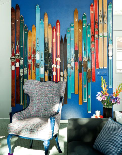 "A bold-color wall will help your collection stand out, whether it's a set of antique plates or a random assortment of vintage skis, like the ones here. ""Because the skis are so many different lengths, we couldn't just arrange them in a straight row. We played around with this jagged pattern on the floor until it looked right,"" Cortney says. ""You don't want everything to be too perfect."""