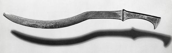 Zubi, espada tipo sappara o khopesh con el nombre del rey Adad-nirari I de Asiria inscrito - 1307-1275 AC - Bronce.