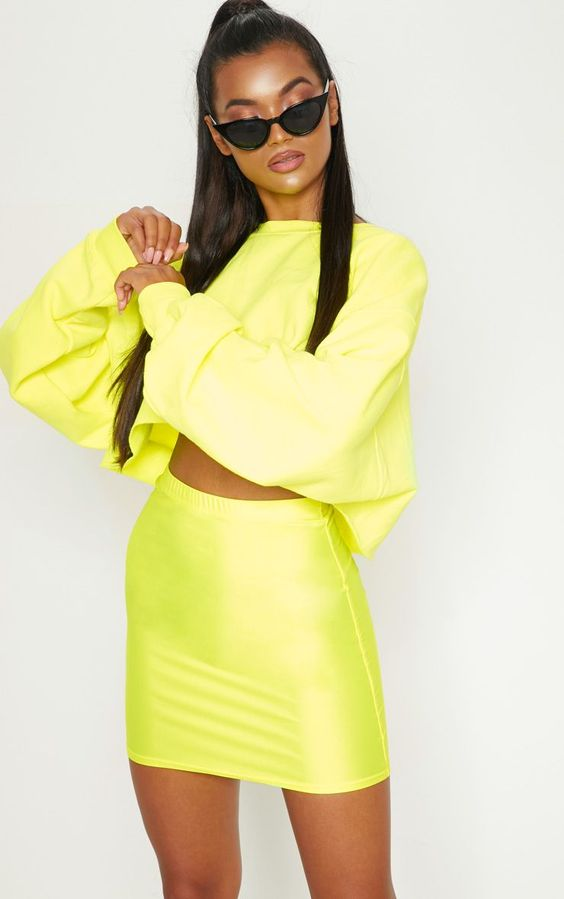 Neon Yellow Disco Mini SkirtWe are obsessing over the current neon trend and this skirt is every...