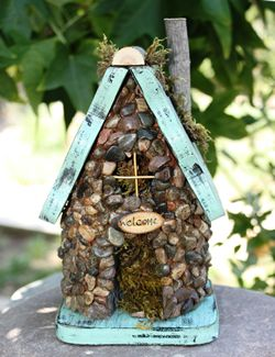 Easily made, with an unfinished bird house and glue on rocks.