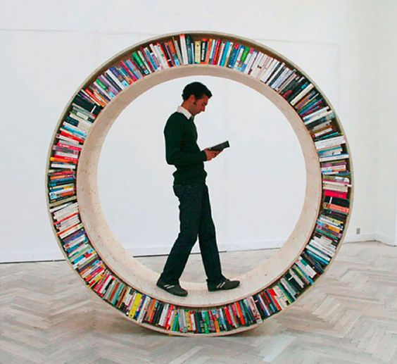 Circular walking bookcase designed by David Garcia - mix of art and design... non functional and not for sale.
