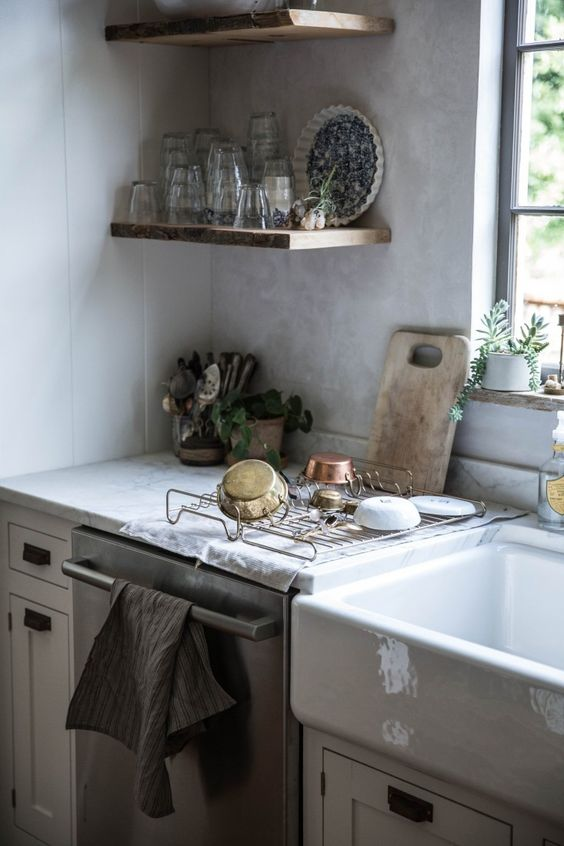 See more of this kitchen! Inspiring kitchen decor and design ideas from Beth Kirby's modern farmhouse kitchen with farm sink, rustic decor, and Venetian plaster walls. #modernfarmhouse #kitchendecor #kitchenideas #farmsink #bethkirby #rusticdeor #shelves #venetianplaster