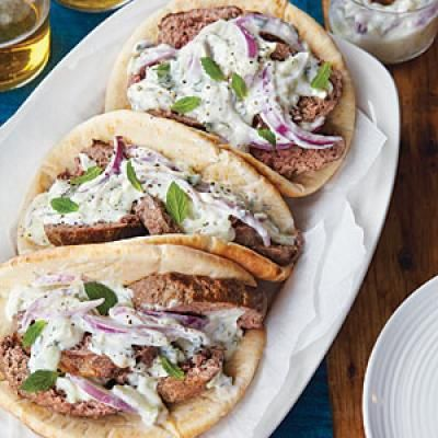 Gyros—thinly sliced meat tucked into pitas and topped with a lightened-up yogurt sauce | CookingLight.com